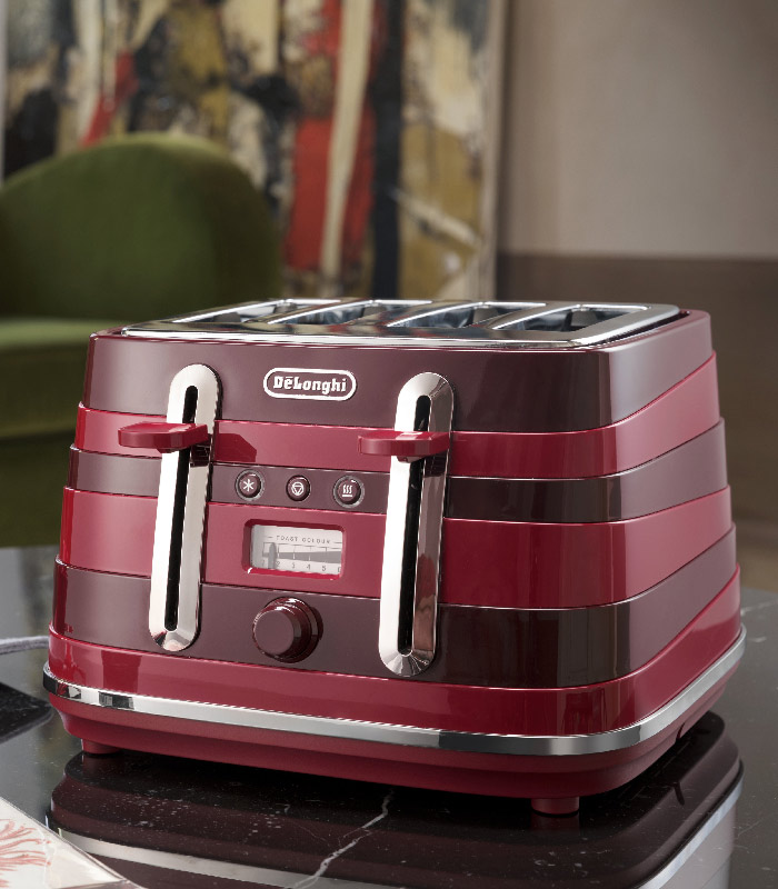 With its innovative aesthetic and its modern design, the Avvolta Class Charming Red 4 slice toaster will adapt itself to any kitchen design. The body is wrapped in horizontal asymmetric resin rings which, drawn by their dynamic lines, evoke constantly moving horizons. Pair the toaster with the 1.7L kettle for the perfect finish. Specifications: -Power: 1800W -4 Slice toaster -Innovative plastic body with precious resin ring wrapped -Chrome details -Electronic controls: reheat, defrost and cancel -Extra lift position -Progressive, electronic browning control -Removable crumb tray -Non-slip feet -1 x Avvolta Class 4-slice toaster -Not dish washer safe. Warranty: 12 Months